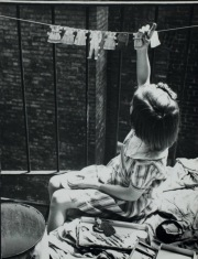 © LUCY ASHJIAN, CA. 1935-36, CHILD HANGING BABY CLOTHES ON CLOTHESLINE