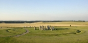 A low aerial photograph of Stonehenge, from the south; the outer bank and ditch can clearly be seen. (James Davies 2006) © English Heritage DP026665