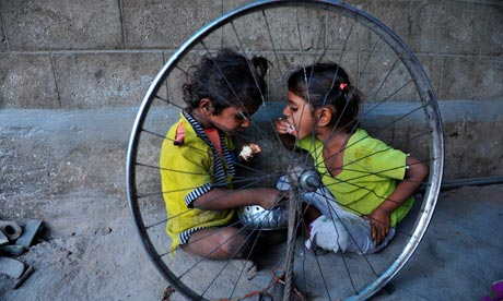 Indian children eat food on the roadside in Hyderabad, 2011. Will extreme poverty have disappeared in 17 years' time? Photograph: Noah Seelam/AFP/Getty Images (SOURCE: guardian.co.uk)